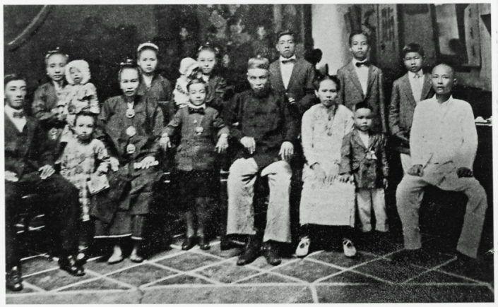 Front row: Cho Kim Choon (1st son), unidentified girl, Kong Moey Yean (1st Mrs Cho Poo, my great grandmother), Cho Jolly (son of Kim Choon), Cho Poo (great grandfather), 2nd Mrs Cho Poo (there was a 3rd wife, not featured), Cho Kim Hock (5th son), unidentified man. Back row: Mrs Cho Kim Choon & baby Mary Cho, Mrs Cho Kim Leong, Mrs Cho Keow Teng and baby, Cho Keow Teng (2nd son), Cho Kim Leong, 3rd son, my grandfather), Cho Kim Tian (4th son).