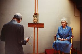 Lucian Freud (1922-2011) compared the task of painting The Queen with that associated with a polar expedition. As an artist who was accustomed to painting his family and friends, he was acutely aware of the need to focus on the 'inner likeness' behind such a recognisable face. Freud attempted to make his task more manageable by using a small canvas only 20 cm high, as that would require fewer sittings. He also decided to depict only The Queen's head and shoulders, rather than paint a full-length image. However, once work had commenced, Freud decided to add the Diamond Diadem, perhaps to make the figure more immediately recognisable, and so had to extend the upper edge of his canvas by 3.5 cm.