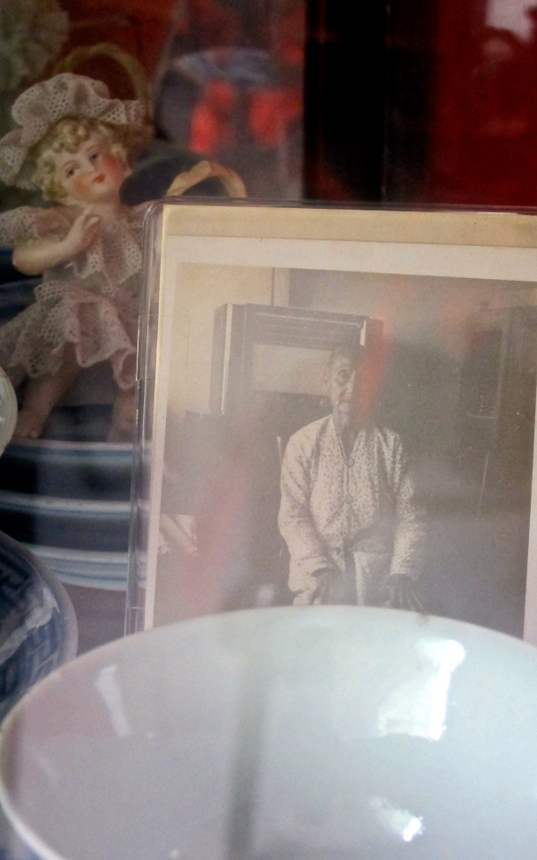 Portrait of the late Mdm. Tan Chwee Neo displayed in Norman's home